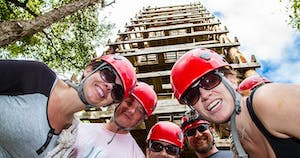 group of zipliners standing over camera