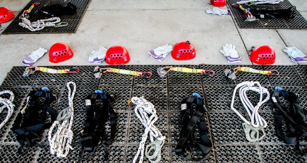 helmets, harnesses, and other zipline equipment