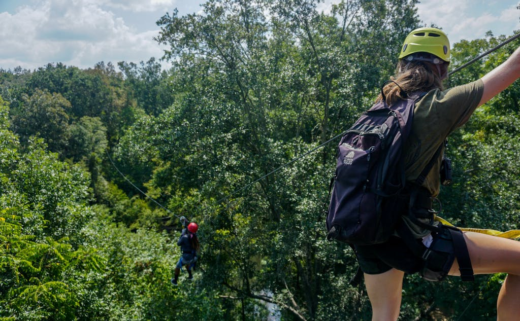 Instructor teaching students how to zipline safely at Canaan Zipline Canopy Tour near Charlotte