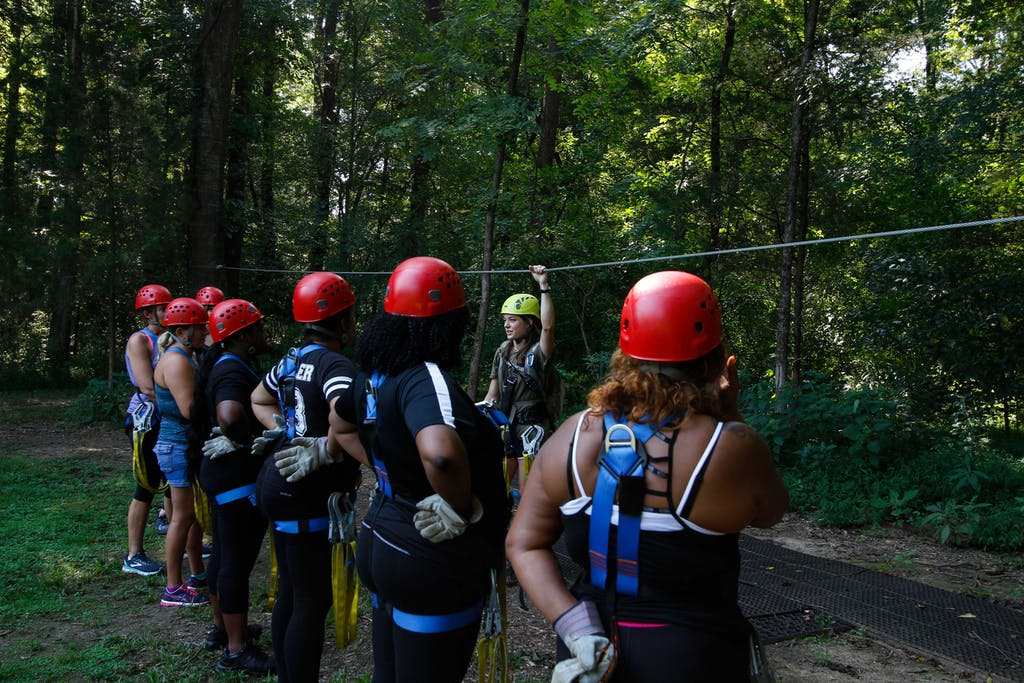 Group of girls learning to zipline at Canaan Zipline Tours near Charlotte