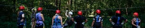 Zipline instructor showing a group how to slow down and brake on a zipline at Canaan Zipline Canopy Tour near Charlotte NC