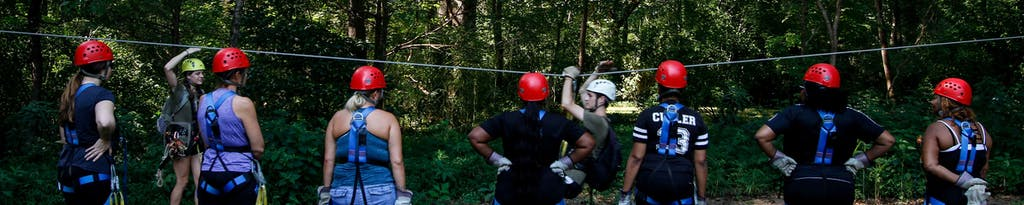 Trainer explaining zipline safety before a treetop canopy tour at Canaan Zipline Canopy Tours near Charlotte, NC