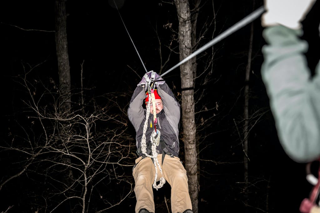 a man ziplining in cold weather in the winter at Canaan Zipline Canopy Tour near Charlotte