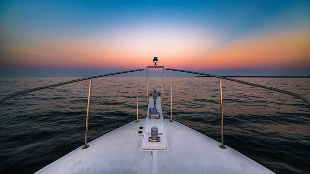 sunset view from the nose of the boat