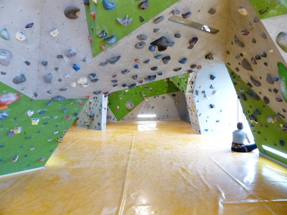 Artificial rock climbing walls with padded floors are commonly used for practising bouldering.