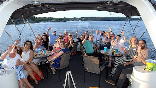 Guests enjoying drinks & food on Lake Hickory cruise