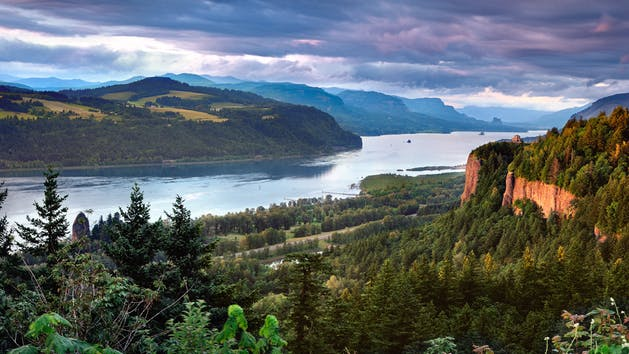 a body of water with Columbia River Gorge in the background