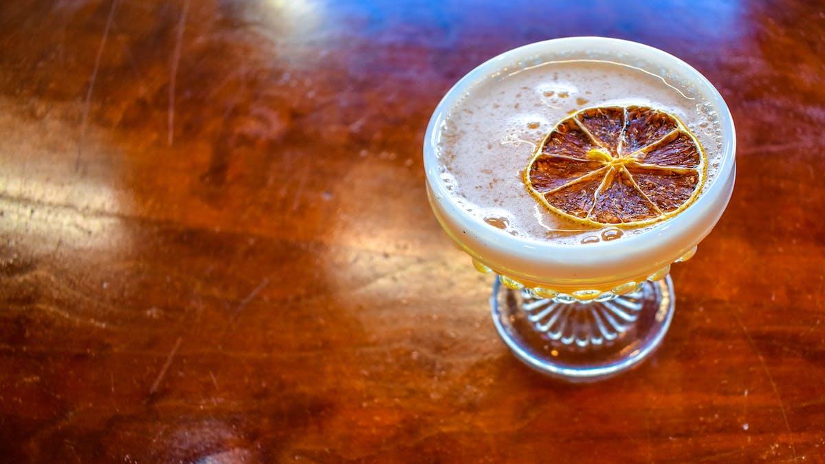 Image of cocktail with blood orange garnish
