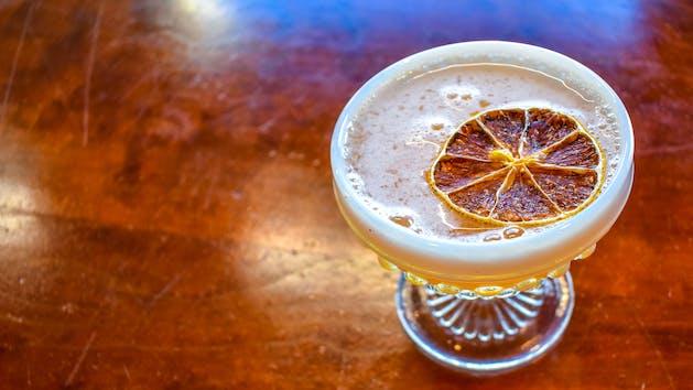 cocktail with blood orange garnish