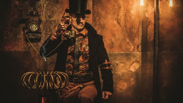 steampunk man with tesla coil on vintage steampunk