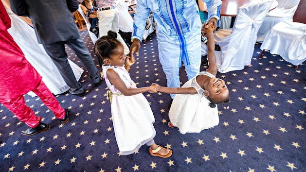 Fathers and daughters dancing