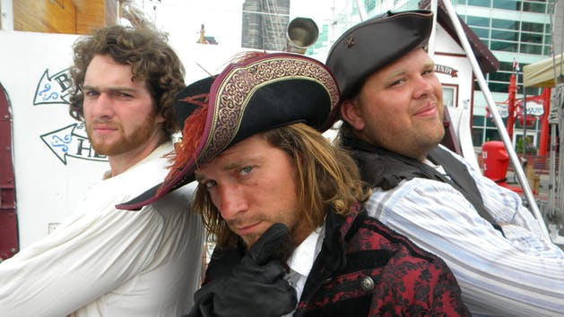 three pirates posing and looking tough