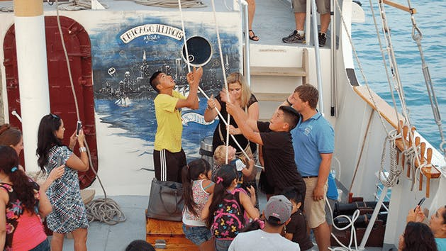 Kids using pulleys on Tall Ship Windy in Chicago