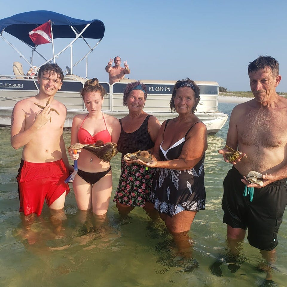 Family enjoying Shell Island on their pontoon rental