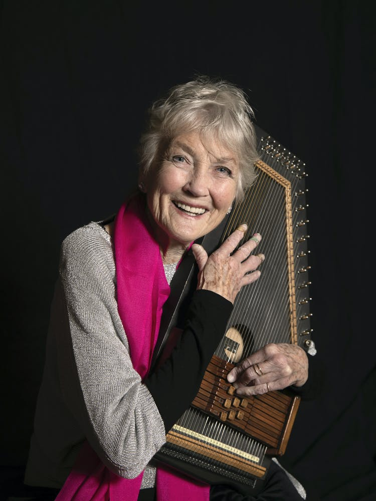 Peggy Seeger talking on a cell phone