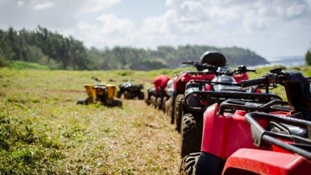 a line of atv's in a field