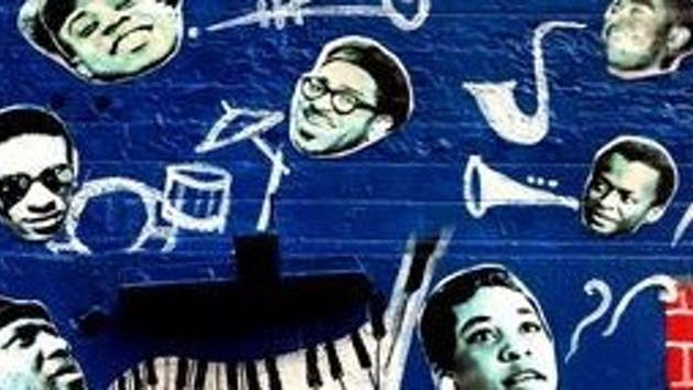 graffiti of Jazz artists on a blue wall along with instruments