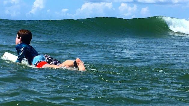 Boy surfing