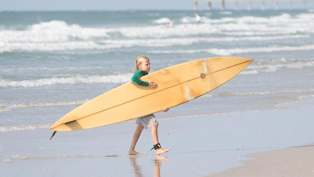 Kid with surfboard
