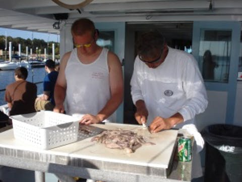 Gutting fish on Capt. Hook boat