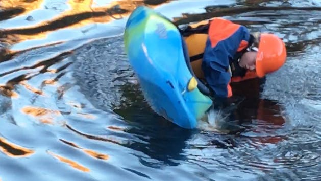 Kayaker performs River/Lake Roll