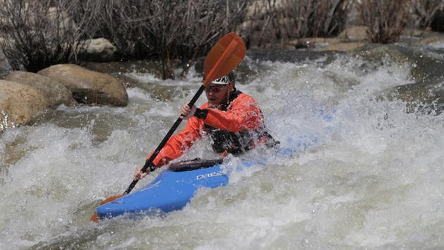 Whitewater Kayakers shredding Class IV