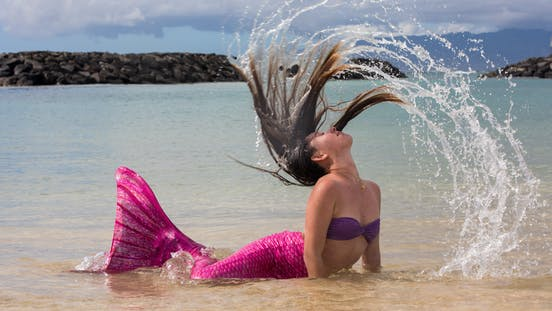 A mermaid flipping her hair in Honolulu, HI
