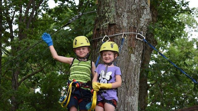 2 young children enjoying the Soaring Six kid-friendly zipline