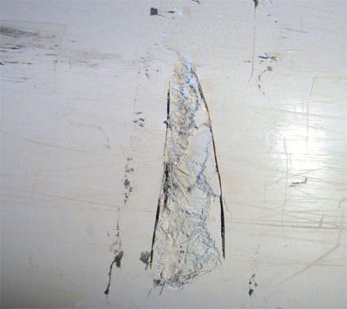 closeup view of damaged hull.