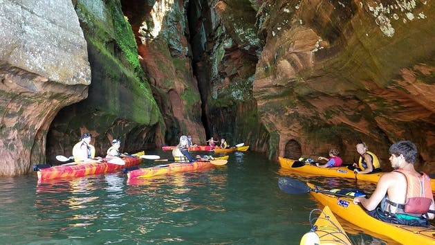 A group going through the caverns at Apostle Island