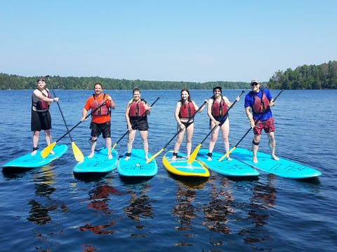 family doing stand up paddleboard