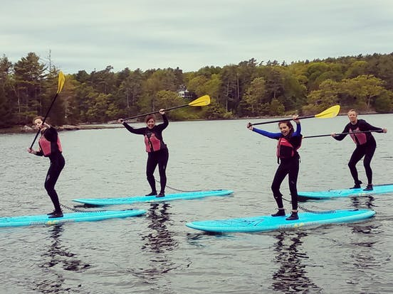 Girls on stand up paddleboards