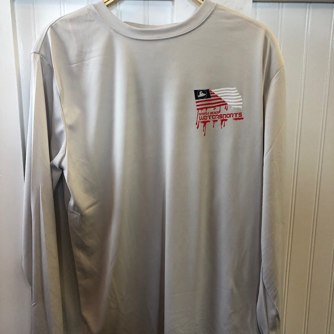 grey long sleeve shirt with flag