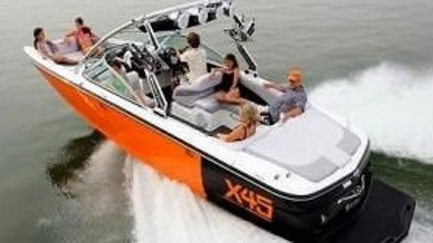 Group in VIP Mastercraft X45 boat