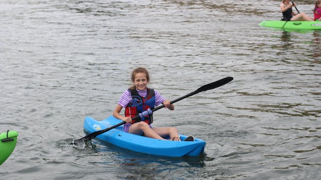 Girl in single kayak