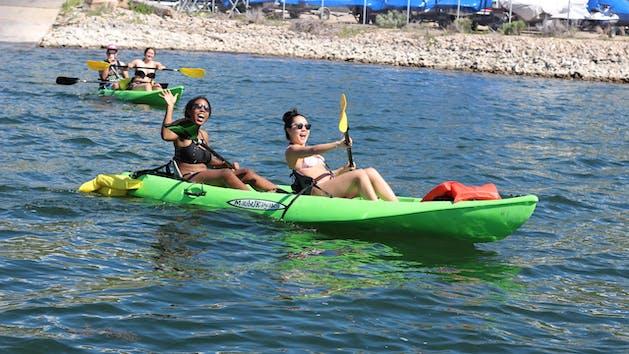 Girls in tandem kayak smiling