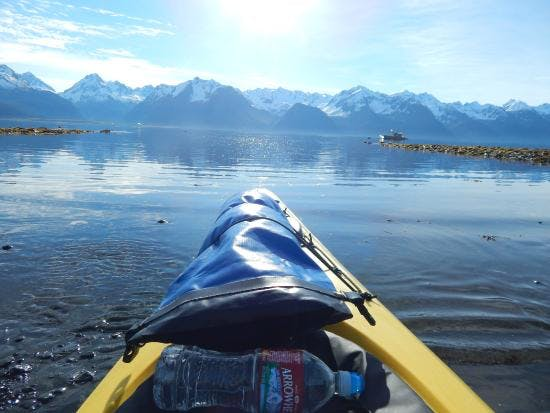 A gorgeous morning meets this paddler ready for adventure- our Best of Alaska day trip is 12 hours long!