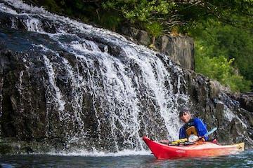 Kayaking through a waterfall, Seward, AK