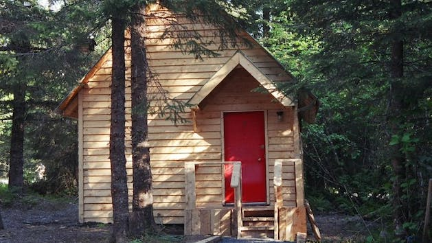 Raven Cabin with a red door