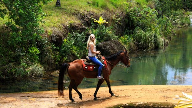 Girl riding a horse in hawaii