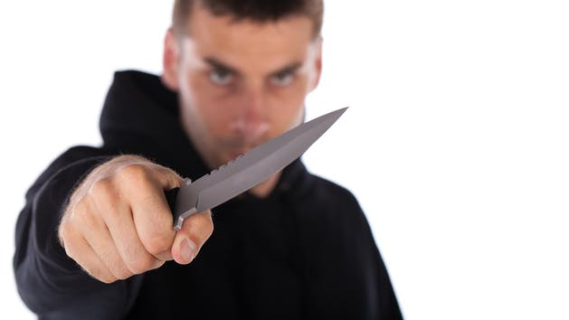 Man holding his knife towards you