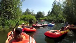 people floating down a river of rafts