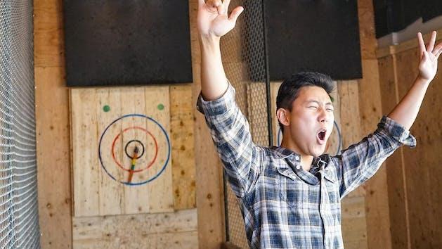 Celebrating an axe throwing win