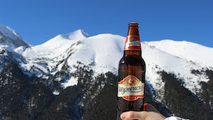 A beer being raised to a mountain in celebration