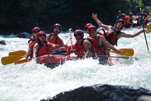 People in white water raft around whistler