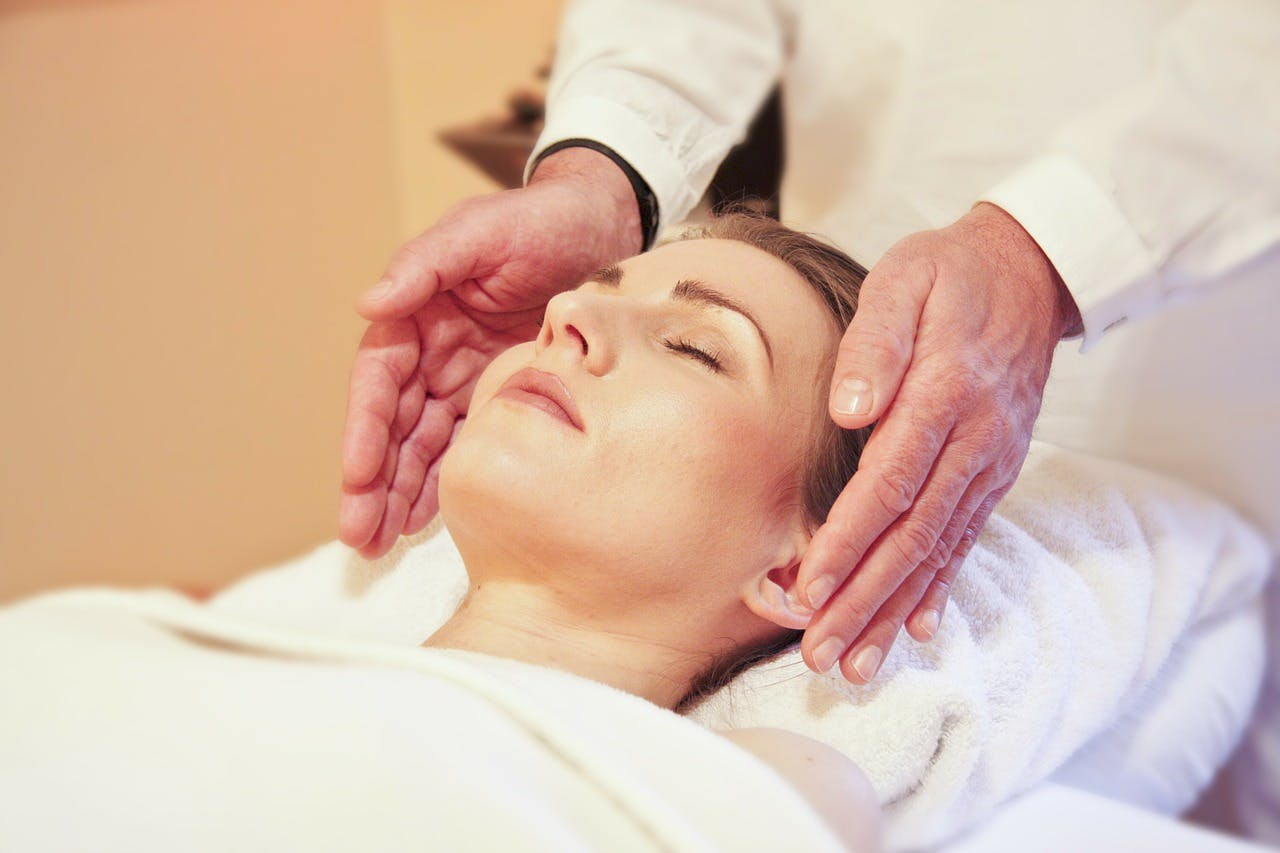 A woman getting reiki