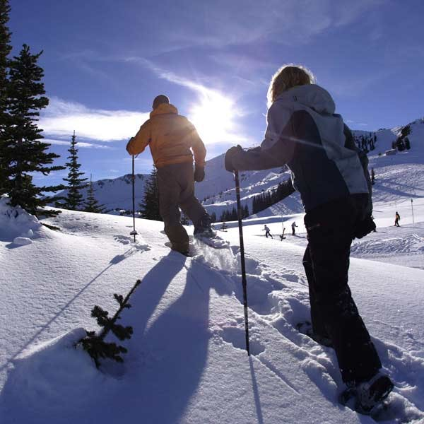 Two people snowshoeing in Whistler