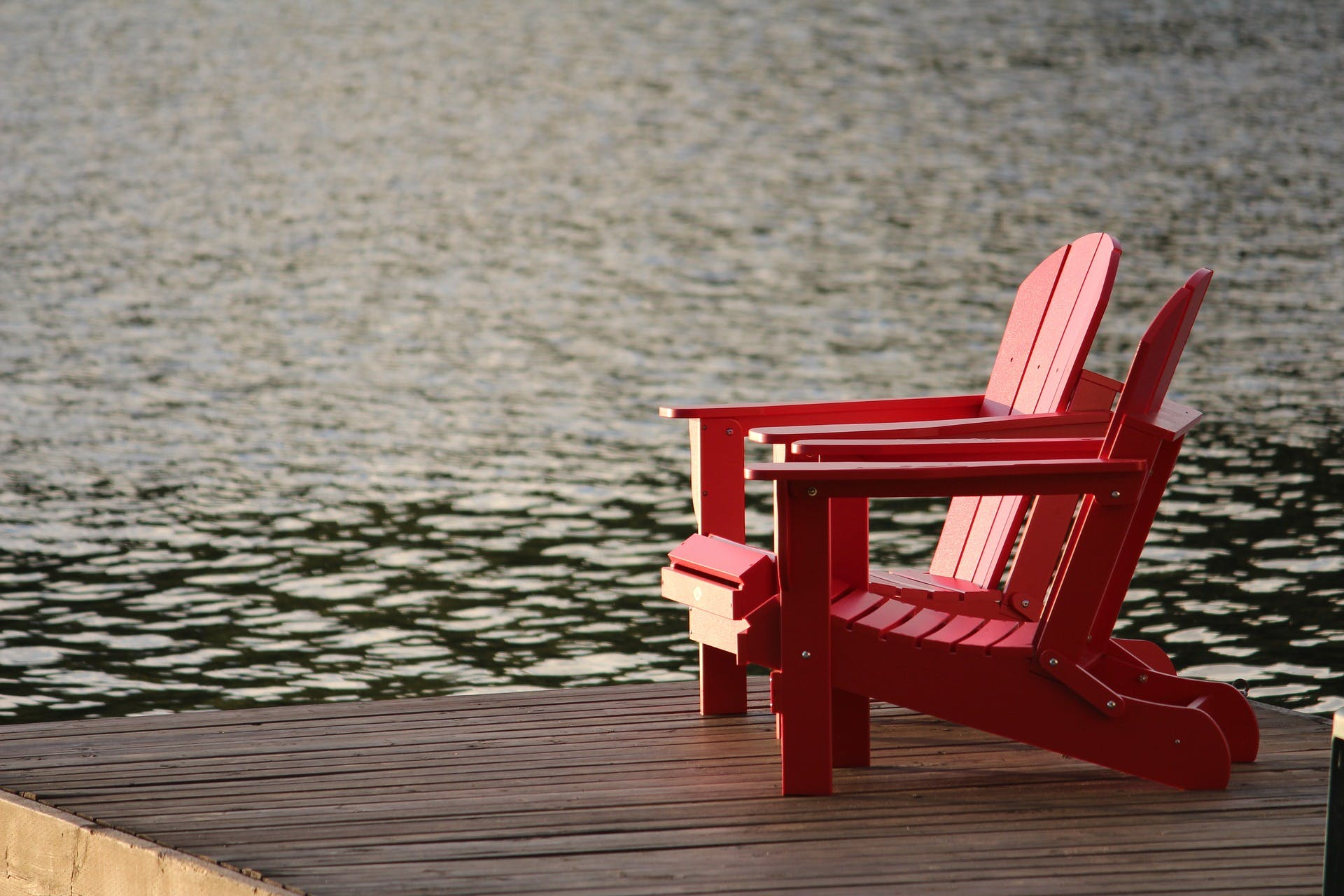 Two chairs beside a lake, long weekend