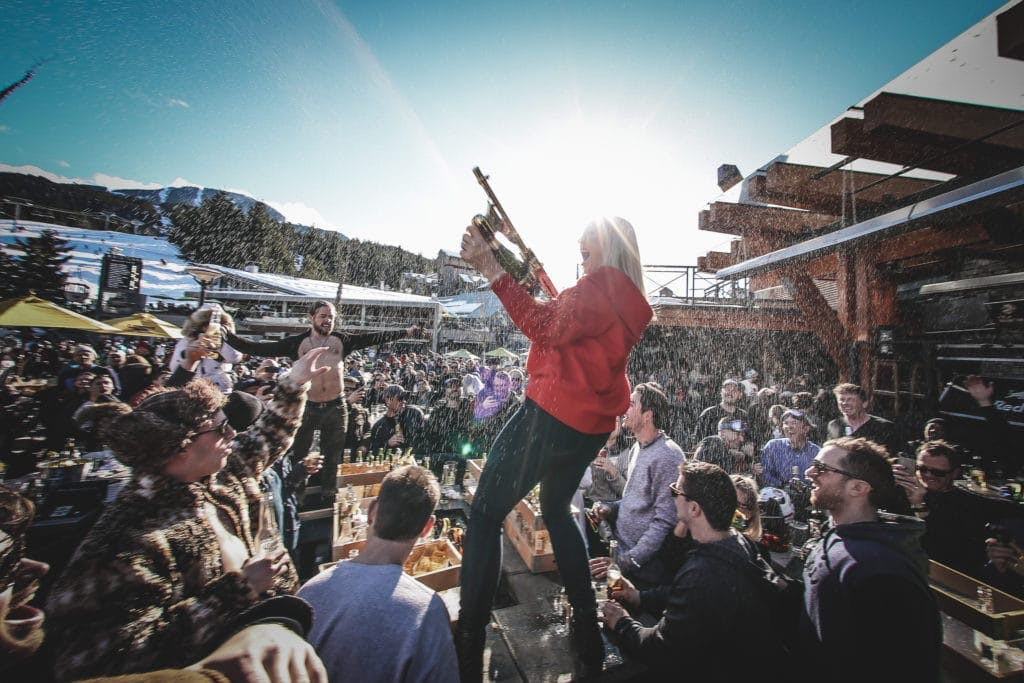 Longhorn pub patio. Woman spraying champagne on the crowd