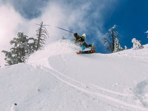 Man skiing down a hill in Whistler